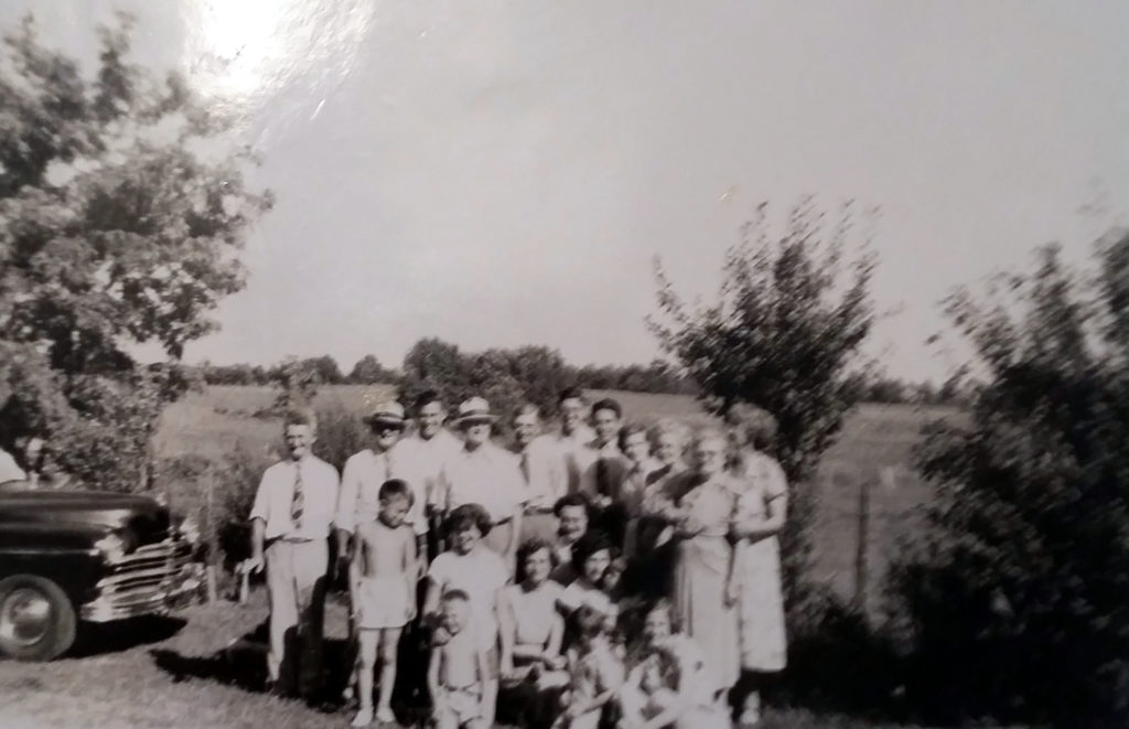 Abt. 1950 kneeling L to R...Steve, Jim, Nancy Carol,.Margaret, David, Nancy, Helen, Ladye Frances, Dorothy, David began the previous 2nd row. standing, L to R, Uncle Alviee, Daddy, Uncle Walter Nichols, Uncle Marvin, Walter(my brother),Aunt Gertrude. (Uncle Ross widow) Aunt Effie, Aunt Mat, My Mother, Mary, Back row standing, continued: Elbert, Jr and Richard. This was the last time Dad's brothers and sisters were all together.